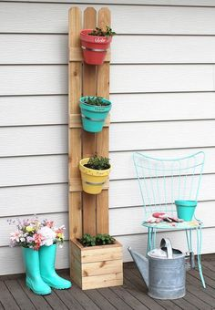 DIY: vertical planter. Grow herbs or flowers in only one square foot. An easy build. It's so cute! #gardendesign