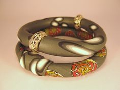 Beautiful polymer bangles. Love the olive color.