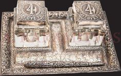 "Silver Inkwell, 4th of August - METAXAS Regime (4η Αυγούστου - ΜΕΤΑΞΑΣ), 1937-1939 prob. from Ioannina (Ιωάννινα). Two inkwells with silver lids & inscription ""4 ΑΥΓΟΥΣΤΟΥ"", silver base & pen holder (κοντυλοφόρο). Dim.: Length: 20 cm, Width: 15 cm, Height: 9 cm. Small crack on one inkwell. Rare."