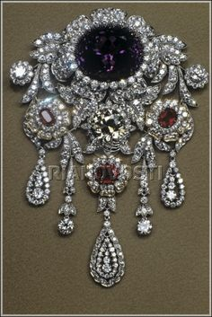 Brooch of Diamond Fund of Russia.  Platinum and Gold.  Diamonds - 480 pc. (36.01 carats). Rubies - 3 pcs. (4.57 ct.).  Amethyst - 1pc. (8.38 ct.) Dimensions: 11,0 x 8,0 cm.  Moscow, Russia. 1993