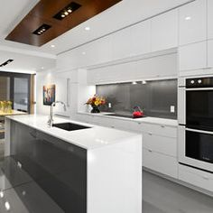 Ceasarstone Nougat benchtops. Like the same splashback and front panel on the island bench.