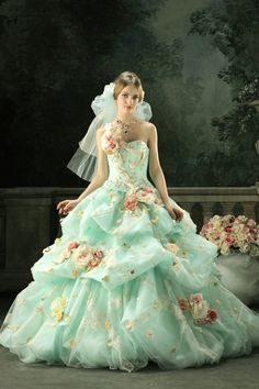 Pastel Gown. Jaw dropping dress with flowers decorating the ruffle mesh skirt. I have sketched it in my sketch book