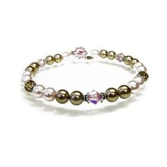 """This sensational design called """"Raspberry Chocolate Truffle"""" features pale bronze Swarovski pearls, complimented by pale pink Swarovski pearls to create the classic pink and brown combination. Sterling silver Bali bead caps, pale pink and topaz Swaro arrangement of Swarovski Crystal designer jewellery and many other tastefully adorned pieces of fashion jewellery.  Find"""