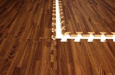 Premium Soft Wood Tiles - Interlocking Foam Mats. They have a grey wood that would be cool in the basement.