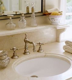 The custom mantel above the faucets give added space especially for her side of the sink. Fixtures are nice too.
