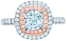 Tiffany and Co's Soleste engagement ring, featuring a cushion-cut white diamond bordered with pink diamonds in rose gold and white diamonds in platinum.  Via Diamonds in the Library.