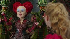 In this video from Disney's Alice Through The Looking Glass we get a look at the Red Queen's newer look. This looks like a darker, more twisted version than the original Alice in Wonderland. Her hair looks a bit crazier and her makeup more stark.