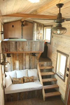 A beautiful custom rustic home from SimBLISSity Tiny Homes. Made from a pine and corrugated metal exterior with a warm, cabin-like interior. - not into the rustic look but like the use of space between bedroom and seating area. #LogHomeDecorating