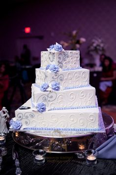 White and purple decorated wedding cake at the Crystal Ballroom of the Radisson Freehold. Wedding cakes are included in all of our packages and are created by a fabulous local bakery, @choccarousel! Photo courtesy of Dammin Senerat Photography. www.crystalballroomnj.com