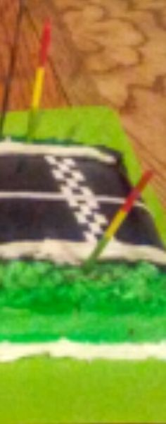 Road was sprayed with black food coloring.  Checkered flag is white fondant squares.