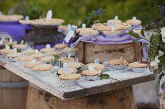 Pies galore.  old door + barrels = rustic table. love it!