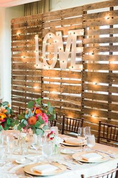 rustic love wood pallets backdrop wedding party table / http://www.deerpearlflowers.com/perfect-rustic-wedding-ideas/2/