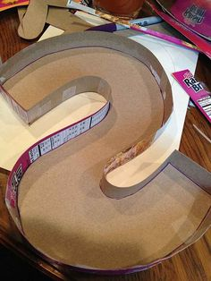 diy cardboard and yarn letters - takes patience, but GREAT results, and nearly f. diy cardboard an Cardboard Letters, Diy Cardboard, Letter A Crafts, Monogram Letters, Yarn Letters, Styrofoam Letters, Free Monogram, Cardboard Furniture, Wood Letters