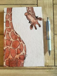 Perfect for taking notes at school or practicing your drawing skills, this one of a kind notebook is a must have! This handmade book features 96 pages lined, bullet, or blank and a beautiful coptic binding that allows the book to lie completely flat when Watercolor Sketchbook, Sketchbook Cover, Sketchbook Drawings, Easy Drawings, Art Sketches, Giraffe Drawing, Giraffe Painting, Cartoon Drawings, Animal Drawings
