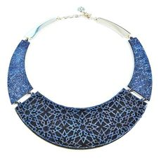 Azaya leather laser cut necklace. The laser cut pattern is inspired by Moroccan tile patterns and architectural elements.