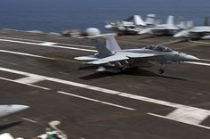 An F/A-18F Super Hornet assigned to the Jolly Rogers of Strike Fighter Squadron (VFA) 103 lands on the flight deck of Nimitz-class aircraft carrier USS Dwight D. Eisenhower (CVN 69).