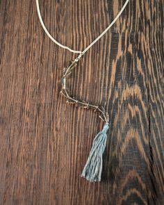 -8x7mm Smokey Quartz Triangles  -Y neck design  -925 Sterling Silver, Silver Fill, 100% Silk  -Length 17 inches + 2 inch extender  -3 inch Arrow Drop with 1 3/4 inch silk tassel.    I've always loved Y-necklaces for their flirty look. They are even better when they use a cool shaped bead is used for the drop. When I first saw these cool smokey quartz triangles I knew I needed to make this necklace with them. 3 inches of smokey quartz triangles form the long drop and are finished off with a…
