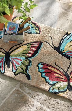 The most delicate of creatures provides charming contrast to the rugged qualities of our Butterfly Outdoor Mat.