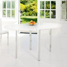 A contemporary take on a drop leaf table, the high gloss finish breathes new life into this classic design. With the ability to raise the leaves independently, it will be great if you don't need it in its full position all the time. There's also a concealed drawer in the central piece for storage.