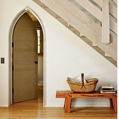 gothic door way to bathroom under stairs.