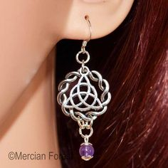 Welcome to our listing for one pair of Celtic Circle Triquetra Earrings with beautiful Amethyst.  The earrings are hand crafted using marked sterling silver earring hooks. The Triquetra and Celtic Circle from Tibetan Silver, finished with a genuine Amethyst bead dangling elegantly underneath. Please note that, though the hooks are sterling silver, the other findings used to craft the earrings are either silver plated or Tibetan Silver. Celtic Circle, Pagan Jewelry, Triquetra, Amethyst, Dangles, Wiccan Witch, Drop Earrings, Sterling Silver, Beads