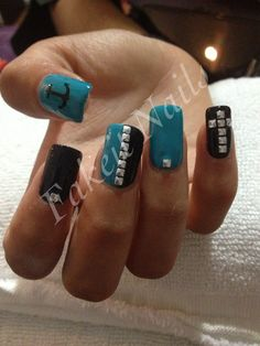 Blue & black acrylic nails with studded designs & anchor feature by Fakeit Nails