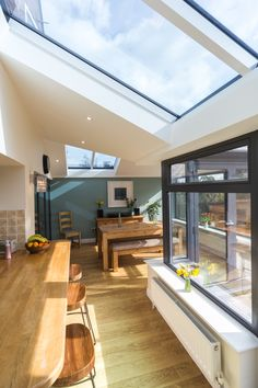 Discover a tiled conservatory roof that's also glazed with the Ultraroof. Tiled Conservatory Roof, Modern Conservatory, Conservatory Extension, Conservatory Kitchen, Conservatory Ideas Interior Decor, Orangery Extension Kitchen, Conservatory Lighting, Conservatory Interiors, House Extension Plans