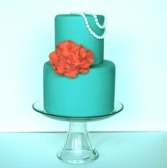 Teal cake with pearls - This was a 6 inch and 4 inch round. Gumpaste fantasy flower and pearls.