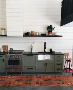 Wood paneling's having a major moment. It's now being found on multiple surfaces in multiple formats, from shiplap to plywood. How about taking it to the next level? Check out this kitchen's range hood that's been covered in shiplap, too!