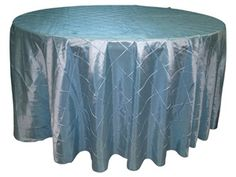 Blue Pintuck Table Overlay provided by Waterford Event Rentals.