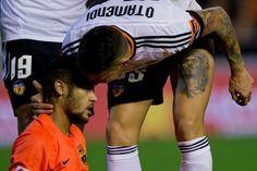 Neymar JR. (L) touches Nicolas Otamendi (R) head of Valencia CF during the La Liga match between Valencia CF and FC Barcelona at Estadi de Mestalla on November 30, 2014 in Valencia, Spain.
