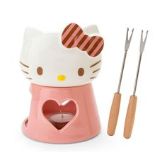 HELLO KITTY Fondue Set - Pink. Comes with 1 x fondue bowl, 1 x fondue base, 1 x candle and 2 x forks. Have a fun fondue party at home with Hello Kitty!  Production: Made in Japan Size: Approx.11.5×11.5×17cm Delivery: Directly from the land of Hello Kitty, Japan!