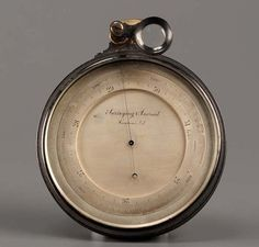 A compensating surveying aneroid barometer with silvered dial and brass scale adjustment #ukauctioneers #shipping