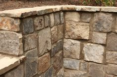 Tennessee ashlar fieldstone retaining wall.  Crab Orchard cap.