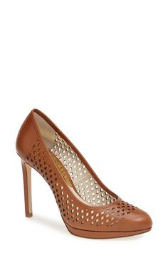 Free shipping and returns on MICHAEL Michael Kors 'Florentine' Perforated Platform Pump (Women) at Nordstrom.com. Diamond perforations lend modern edge to an almond-toe pump featuring logo-etched hardware at the heel for a flashy finish.