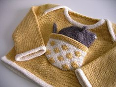 Hickory Dickory Dot Baby Sweater Pattern by Anny Purls - this sweater is so dang cute, I would love to see my nephew in a green version of this!