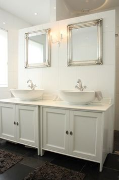 To make more room in the master bathroom, the couple opened the original slanted ceiling and added a dividing wall in the middle of the room, with the shower on one side and the toilet on the other.     Simple Ikea cabinets are used as his-and-her sink vanities, although the couple plans to replace them soon.
