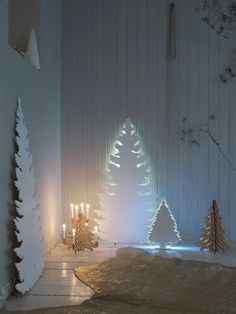 This would bro lovely for a winter wedding. Cut out of white plastic cardboard or get a refrigerator box, cut it to shape and paint white. The secret is the led lights behind them.