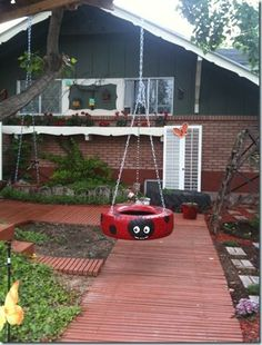 "<a href=""http://janiszettel.blogspot.in/2010/06/were-swingin-group.html"" target=""_blank""><strong>Tire Swings</strong> </a>are the most classic way you can recycle an old tire. But this cute lady bug version is probably the sweetest one I've ever seen."