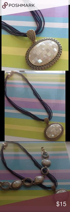 Lia Sophia Mother Of Pearl Necklace Antiqued gold over rhodium, beautiful oval mother of pearl Pendant, hung from cords. Lia Sophia Jewelry Necklaces