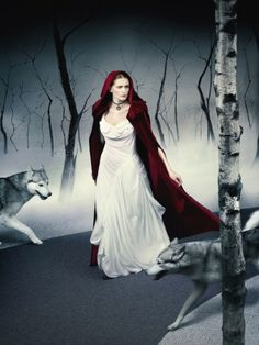 """Little Red Riding Hood """"...A red-headed beauty, adorned with a red hooded cape, walks through the dark, eerie woods to visit her sick grandmother's house. Hungry, deceitful wolves close in around her, tailing behind her on her journey..."""""""