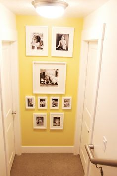 i like this bright lemony yellow… small space color? Maybe our weird hall? It … i like this bright lemony yellow… small space color? Maybe our weird hall? It would certainly brighten things up! Yellow Hallway, Yellow Walls, Love Picture Frames, Picture Groupings, Stair Walls, Small Hallways, Hallway Decorating, Wall Colors, Colours