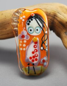 LITTLE MISS glass focal bead orange background by jperaladesigns, $40.00