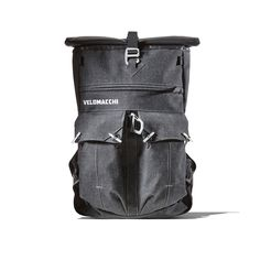 Velomacchi Rolltop Backpack -- A motorcycle specific backpack designed to carry twenty five litres of gear effectively distributing the pack's weight off of your shoulders using a three point rotating harness system and placing the load close to your centre-of-gravity, affording a more aggressive and comfortable riding style for sport riders. Perfect for the weekday commute or overnight weekend trip, with capacity to carry a laptop computer.