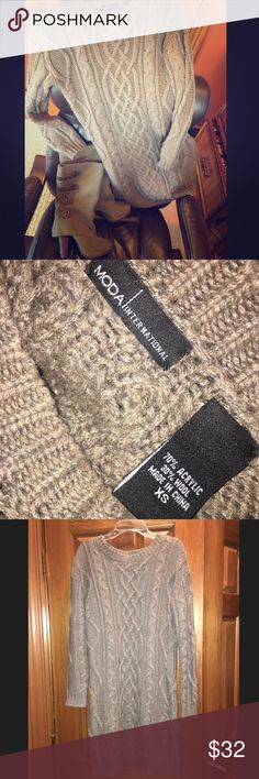 Moda International sweater dress Oversized and comfy sweater dress. Great taupe color. Looks great with boots listed separately in my closet. Size says extra small but it fits more like a generous medium. Reasonable offers are always welcome! Moda International Dresses Long Sleeve