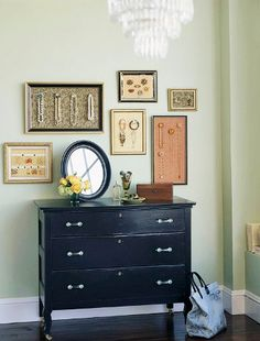 Frame jewelry holders. Several different frames looks chic too. ~kss