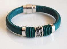 Loving these bracelets.   Teal Green Licorice Leather And Green O ring  Bracelet- Bangle bracelet-  - Cuff Bracelets- Mother's Day