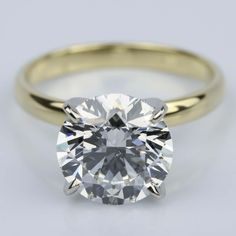 A stunning 3.77 Carat Round Yellow Gold Classic Solitaire Engagement Ring!