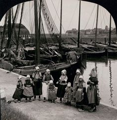 1910 Dutch Girls Holland Wooden Shoes by Sailboats. (Marianne Clancy)