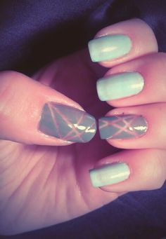 Mint nails and grey ones with transparent pattern.